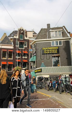Amsterdam the Netherlands - October 03 2015: People waking in histiric city centre