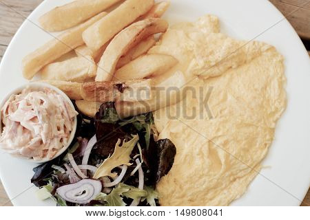 Omelette and chips served with salad and coleslaw - filter applied
