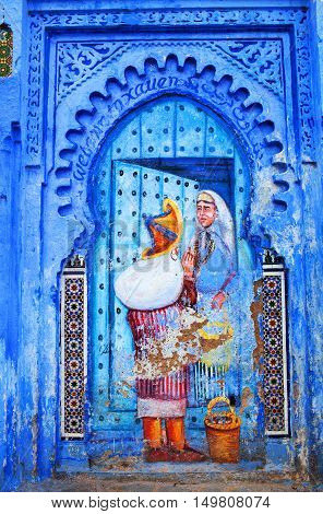 CHEFCHAOUEN, MOROCCO - JANUARY 2, 2014: Fresco painting wall at Uta El-Hammam square in Chefchaouen, Morocco. This is the liveliest square in the Chefchaouen medina.