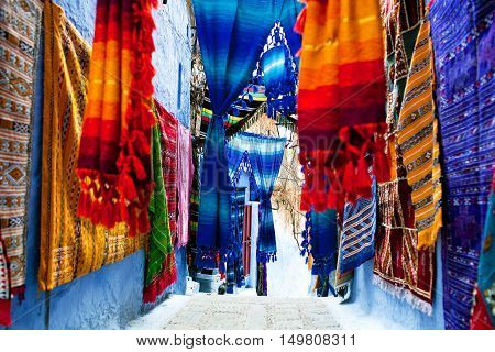 Colorful moroccan fabrics on oriental market in Chefchaouen, Morocco