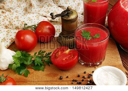 Tomato juice and spices. Ingredient for cooking of tomato soup on chopping board