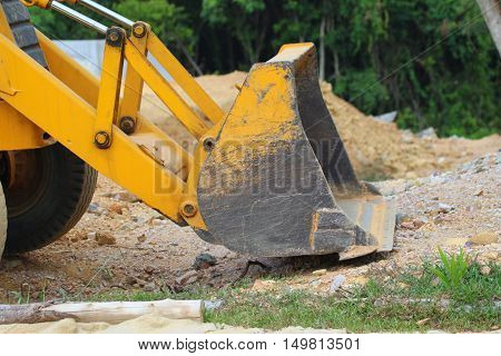 Front bucket on an excavation machine with front and rear power shovels, construction site near Songkhla, Thailand