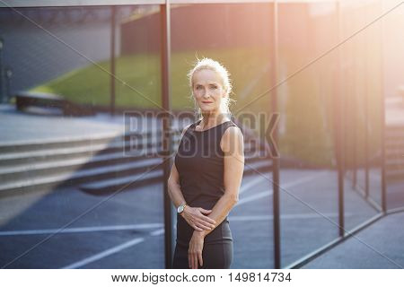 Mature Busineswoman Standing In Front Of Building