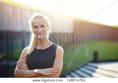 Happy Businesswoman With Crossed Arms