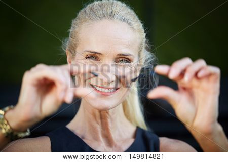 Happy Businesswoman Holding Glasses