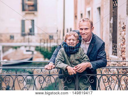 Father and son portrait on the Venetian bridge