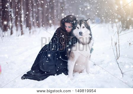 Fairy Tale Girl Embracing Cute Dog In Winter Park.
