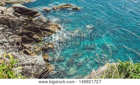 Koh Tao islands in Thailand. Blue clear Water hitting Rocks.