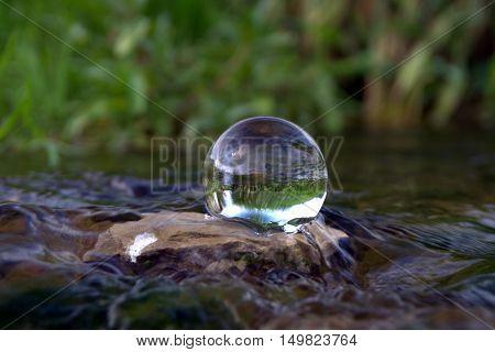 Crystal ball in the water of Vingart creek