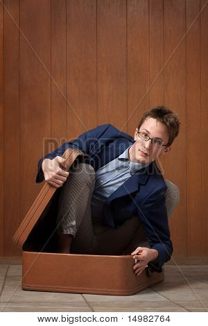 Young Man In Suitcase