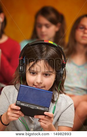 Little Girl Plays A Video Game