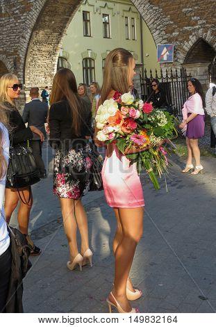 TALLINN ESTONIA - CIRCA JUNE 2012: unidentified sexy girls with elegant dress and flowers attending a ceremony in Tallinn 20 June 2012