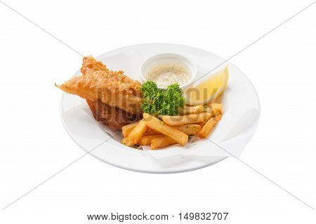 Front view of Traditional British style fish and chips including deep fried cod french fries lemon and tartar sauce in ceramic dish isolated on white background