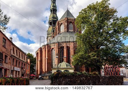 RIGA, LATVIA - OCTOBER 2016: Medieval church in old city of Riga. Riga is the capital and largest city of Latvia, a major commercial, cultural, historical and financial center of the Baltic region
