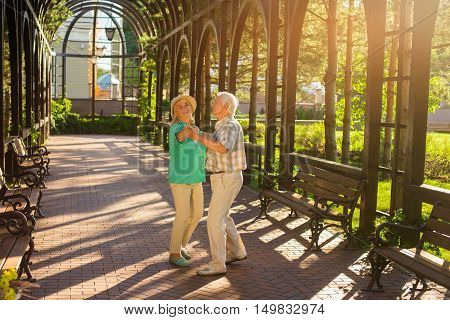 Senior couple is dancing. Smiling elderly woman. I feel young again. Movement is life.