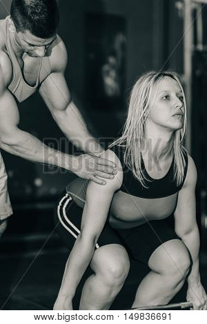Weightlifting training, black and white image, vertical