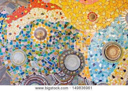Colorful mosaic abstract background made of broken glass and ceramic pots.