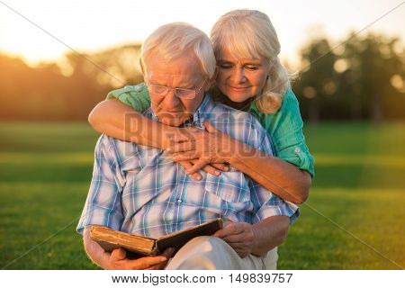 Senior couple reading book. Two elderly people. New chapter of our life. Knowledge and wisdom.