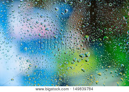 Abstract texture - Water drops on glass with colorful background