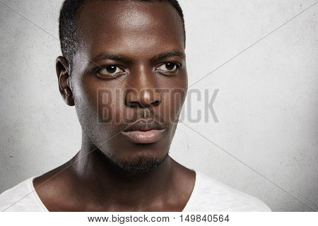 Highly-detailed Close Up Shot Of African Man Looking Serious And Confident, Standing Isolated Agains