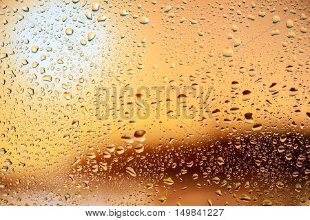 Abstract texture - Water drops on glass with sunset background