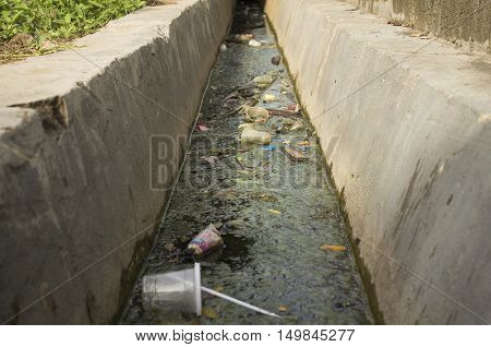 Dirty irrigation ditch Ecological problems heap trash