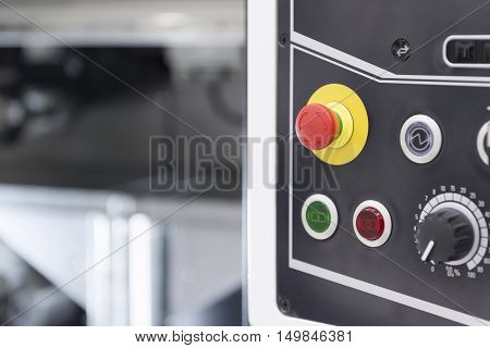 The emergency button or emergency knob of CNC milling machine with the control panel.