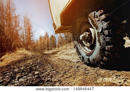 Wheel of car SUV on the offroad and mountains background