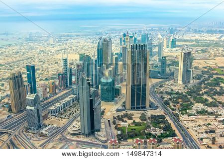 Scenic view of skyscrapers of Dubai downtown skyline on Sheikh Zayed Road in the United Arab Emirates from the top.