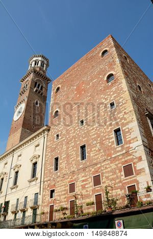 Verona Italy - September 3 2016: Torre dei Lamberti tower on Piazza Delle Erbe square in Verona Italy.