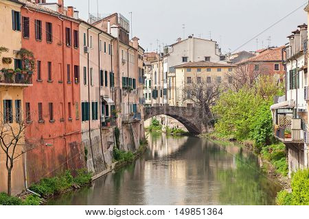 San Leonardo bridge over canal and colorful houses in Padua Italy