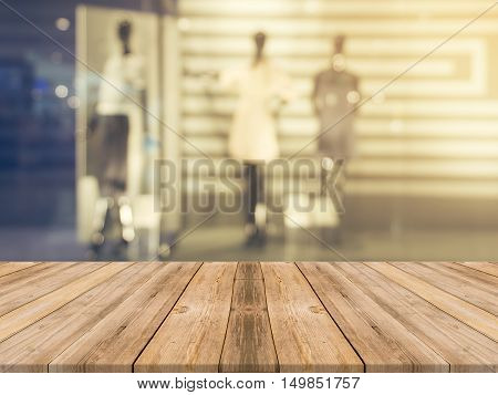 Wooden board empty table blurred background. Perspective brown wood over blur in department store - can be used for display or montage your products. Mock up for display of product.