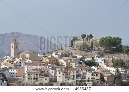 view of church saint peter apostle buildings and castle of polop de la marina
