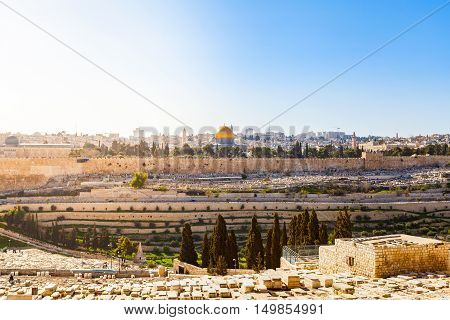 Mount of Olives and the old Jewish cemetery in Jerusalem, Israel. Panoramic view of the old town, Muslim Quarter and Temple Mount. Dome of the Rock.
