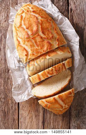 Dutch Crunch Bread Sliced Close-up. Vertical Top View, Rustic