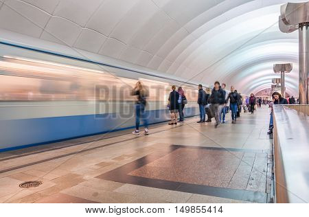 MOSCOW, RUSSIA - OCTOBER 01, 2016: The train arrives at speed in the tunnel at the metro station Timiryazevskaya in Moscow