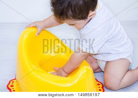 Infant Child Baby Boy Toddler Play With Potty Toilet Stool Pot On A White Background