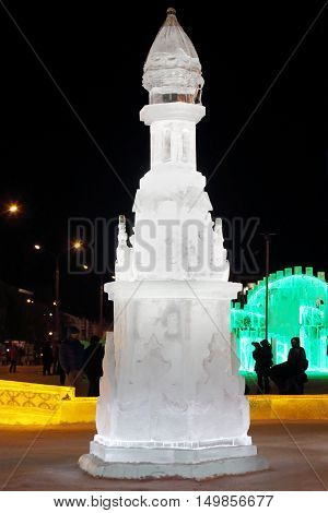 PERM RUSSIA - JAN 4 2016: Tower with illumination in Ice town Ice town in Perm - traditional winter attraction