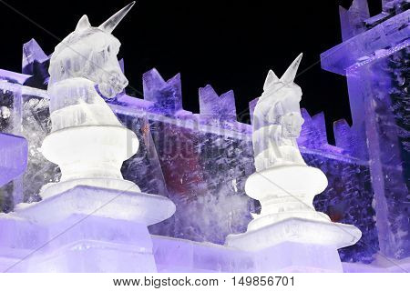 PERM RUSSIA - JAN 4 2016: Illuminated unicorns sculpture in Ice town Ice town in Perm - traditional winter attraction
