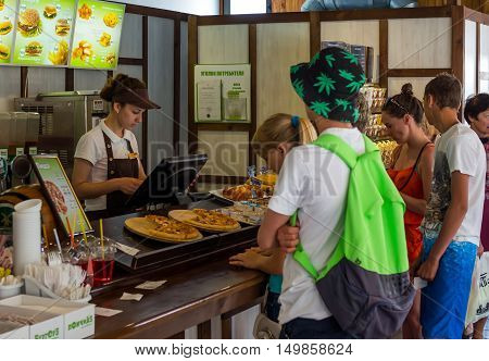 Alushta, Russia - June 12, 2016: The queue at the counter of the cafe