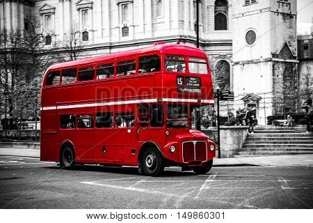 London's iconic red double decker bus on black and white background.