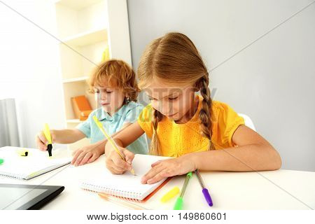 learning and next generation concept, little kids drawing on paper with marker and pen
