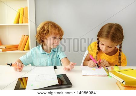 learning and next generation concept, children doing homework