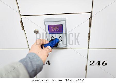 Closeup On Hand Opening Change Room Locker