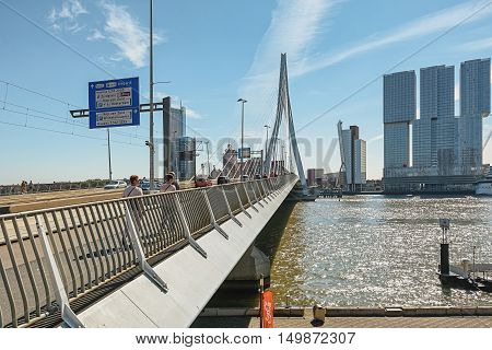 Rotterdam, Netherlands - August 18: Picture of the Erasmus bridge and the buildings Tower on South and The Rotterdam right of the bridge, taken August 18, 2016 in Rotterdam, Netherlands.