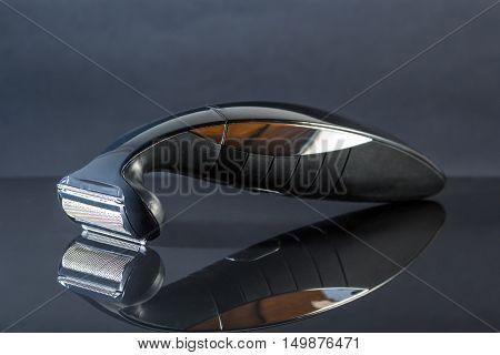 Electric shaver tripper closeup in black background