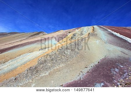 Along the hike up to the Rainbow Mountain near Cusco Peru. Not less colorful. Located about 20km south of Ausangate mountain.