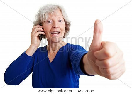Senior Woman With Mobile Phone Holding Thumb Up