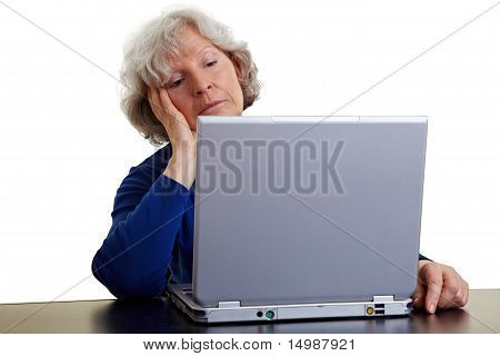 Senior Woman Looking Bored At Laptop