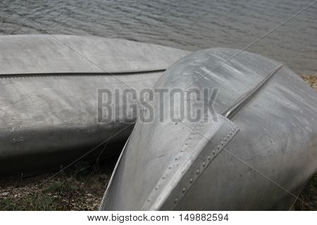 A pair of canoe turned over on the beach on Michigan